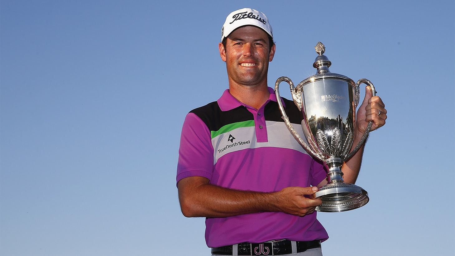 Robert Streb poses with the trophy after winning...