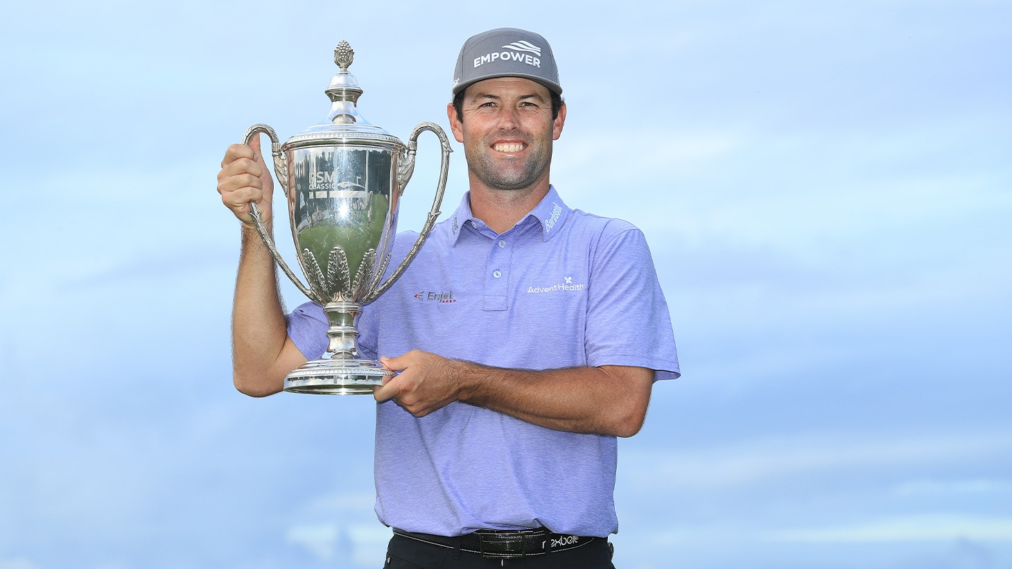 Robert Streb celebrates with the trophy after...