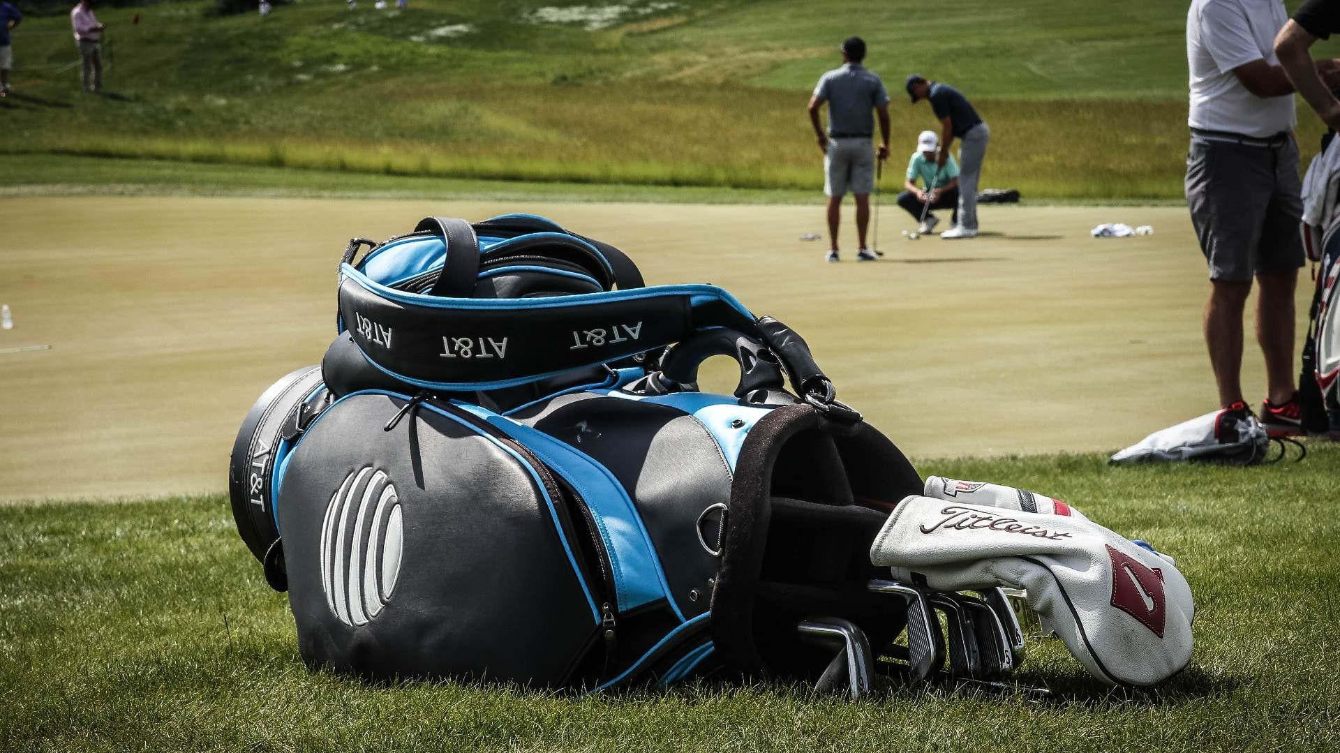 Jordan practices as his bag full of Titleist equip...