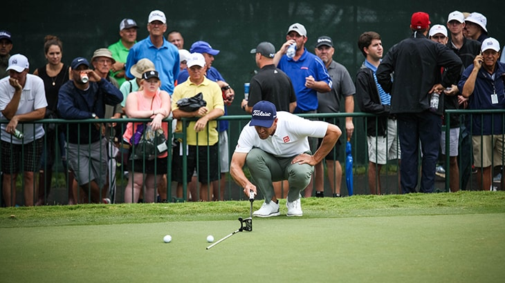 Scott works with his Scotty Cameron putter in...