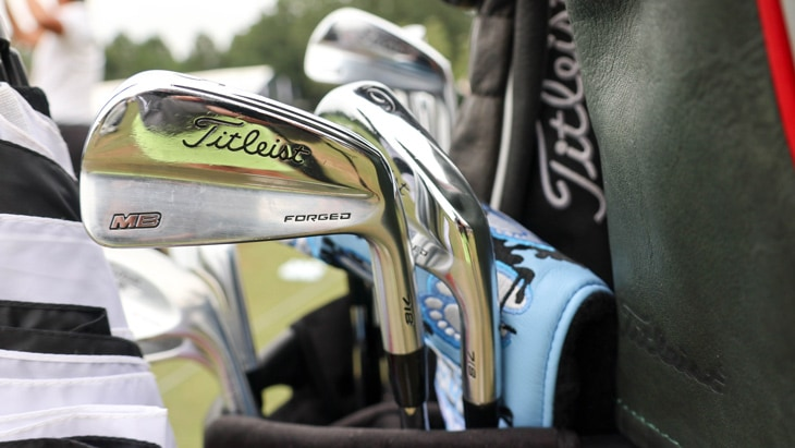 He also has prototype Titleist 718 MB irons in the...