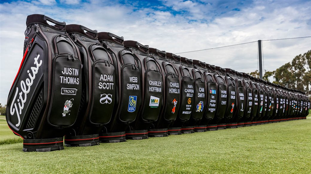 A row of new Titleist Jet Black Tour Bags await players at the Titleist Performance Institute
