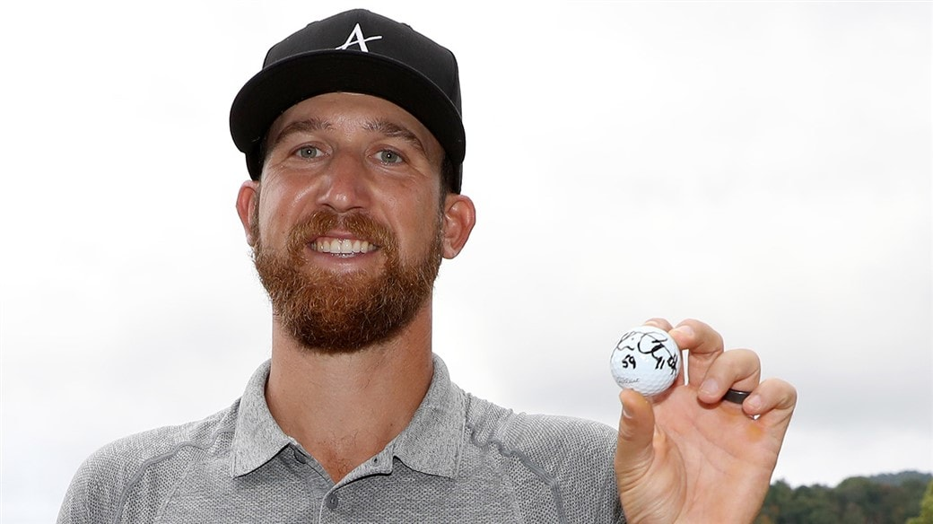 Kevin Chapell raises the Pro V1 golf ball he used to fired a 59 during second round action at the 2019 A Military Tribute at The Greenbrier, the 11th sub-60 in PGA Tour history.
