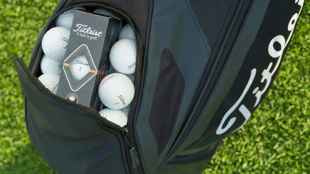 The ball pocket of a Titleist golf bag, filled with Pro V1 golf balls