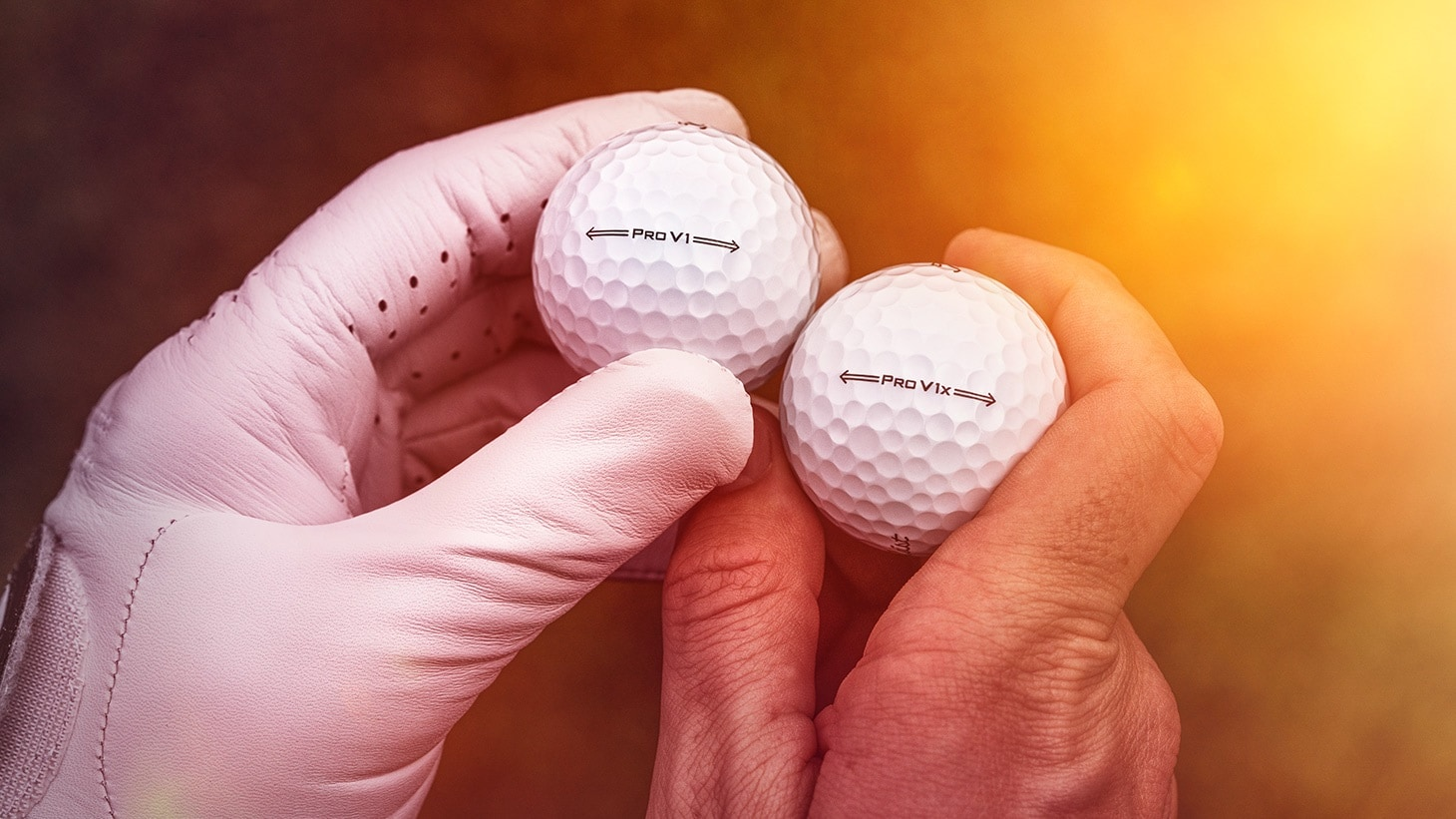 A golfer admires the new sidestamp designs on the 2021 Titleist Pro V1 and Pro V1x golf balls.