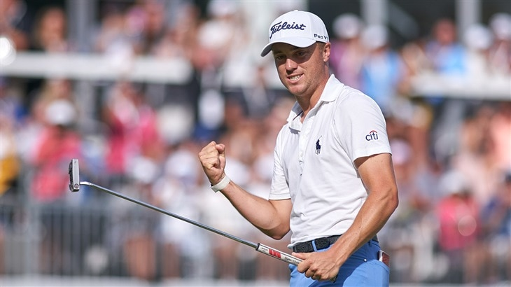 Justin Thomas celebrates after holing the winning putt with his Pro V1x golf ball at the 2019 BMW Championship