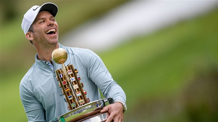 Paul Casey raises the trophy after capturing the 2019 Porsche European Open.